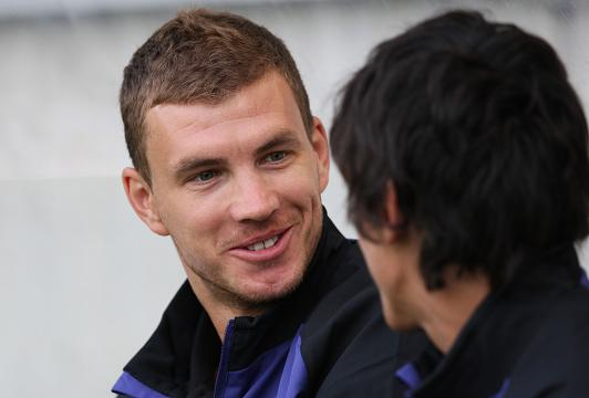 Edin Dzeko played a key part in Manchester City's 2-0 win at Arsenal