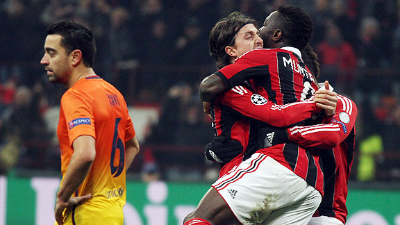 Milan players celebrate their second goal against AC Milan