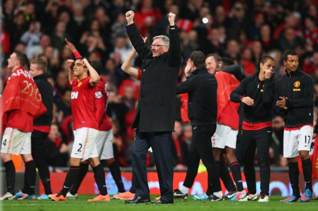 Manchester United's staff and players celebrate Premier League title win