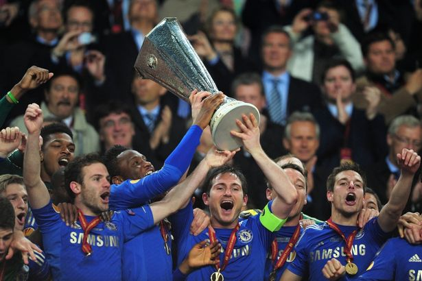 Chelsea players lift the Europa League trophy