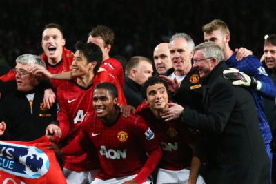 Manchester United players and boss celebrate their Premier League title victory