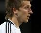 Marin joins Sevilla, as De Guzman returns to Swansea